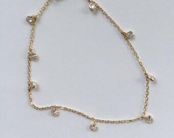 14k solid gold and dangling cubics zirconia , cz, bracelet