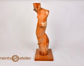 Wooden sculpture. Woman figure