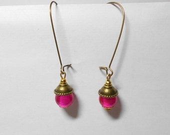 Earrings Leverback bead fuchsia and bronze metal caps