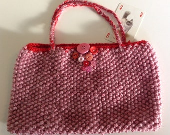 Hand knitted textured patterned small bag