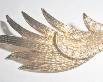 Pretty vintage goldtone abstract leaf or feather brooch with clear rhinestones