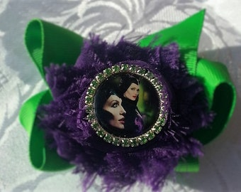 Maleficent - purple shabby flower on green bow.