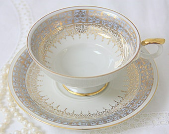 Beautiful Vintage Bavaria Elfenbein Porcelain Teacup and Saucer in White and Light Blue with Gilded Decor, Germany