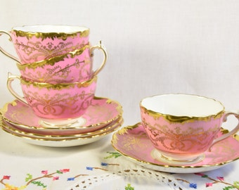 Pink Coalport anniversary tea cups and saucers
