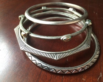 set of four silver bangles