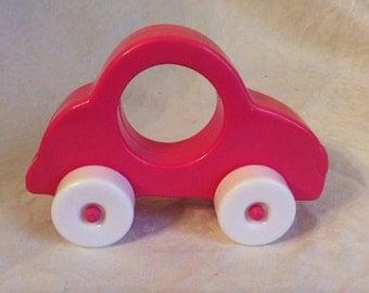 Vintage pink car rattle.