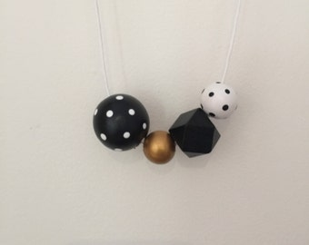 Wooden bead necklace// Geometric and round wooden bead necklace // black white and gold spots // hand painted