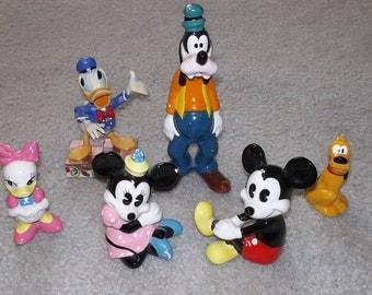 Vintage Disney figurine lot including Mickey, Minnie, Daisy, Goofy, Pluto and Donald Duck