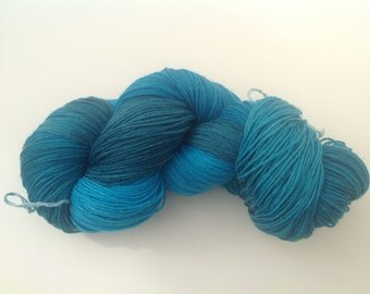 Hand dyed  sock yarn,teal  greens and blues.Superwash merino and nylon blend sock yarn, hand dyed