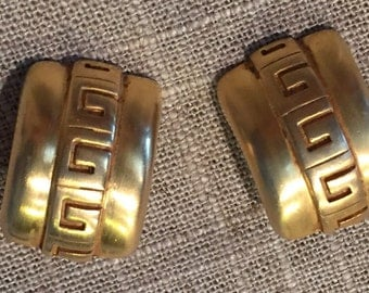 Vintage Givenchy logo earrings in brushed gold tone. Classic Givenchy vintage earrings.