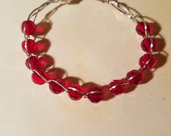 Pretty red crystal beaded wired bracelet.