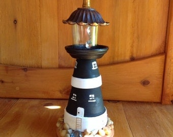 Lighthouse, light house, made from clay pots