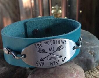 Blue leather cuff bracelet w/added detail.