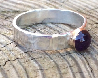 Sterling Silver ring set with a 6mm amethyst cabochon in a filled gold bezel setting