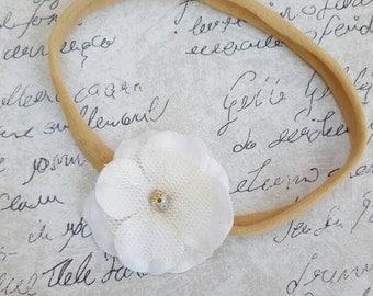 Girls delicate flower on a nylon band
