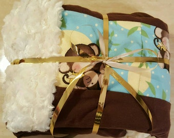 Soft, minky, cuddle/tummy time, baby shower gift