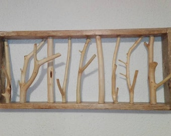 Original wooden hangers olive branches, wood broom and fork