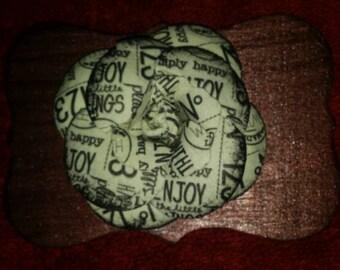 Newsprint flower magnet