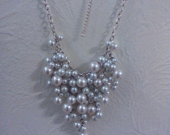 light beige glass pearl cluster on a silver plated chain