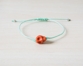 Orange skull bracelet, skull bracelet, tiny skull bracelet, sugar skull bracelet, skull jewelry, small skull bracelet, skull bracelets