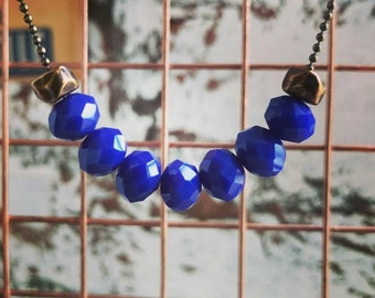 HANDMADE long bronze finished ball chain with 7 dark blue glass faceted beads and 2 bronze beads.