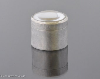 Round sterling silver box with magnifying lens