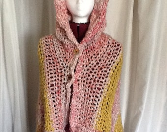 OH so soft hooded, open front Poncho.  Shades of pink and yellow.  Home spun yarn.  Light and beautiful.  Great spring accessory.