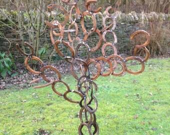Unique horseshoe tree sculpture