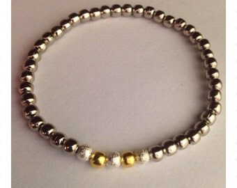 Silver, stardust silver and gold bead bracelet