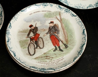 Set of 4 antique French plates 'Les grandes manoeuvres'. Late 19th Century.