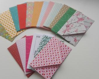10 small envelopes vouchers stained