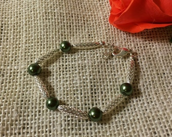Green glass pearls with silver beads