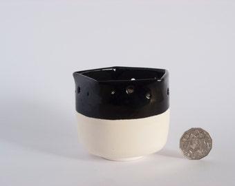 Black pot with half glaze