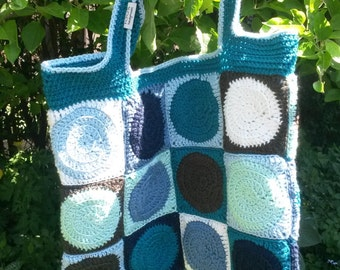 Carrier bag of crochet squares with floral lining