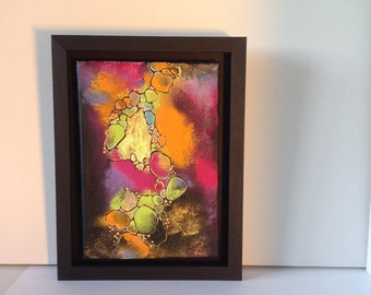 Abstract acrylic artwork with elements of gold leaf.