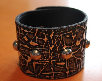upcylced/recycled studded vinyl cuff in black & silver
