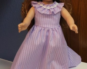 Long dress in purple with ruffle around neckline