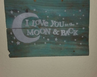 Rustic I love you to the moon and back on teal reclaimed wood! Very nice