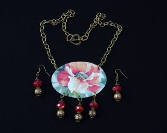 Red flower necklace and gold and red earrings