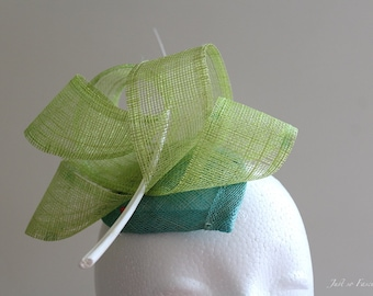 Lime green and teal fascinator with white ostrich feather spine