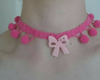 Pom pom and bow charm choker