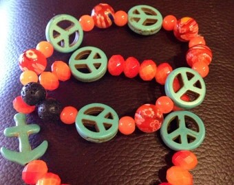 Turquoise and orange lava bead, peace bracelet