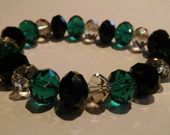 Black, green and clear beaded stretchy bracelet