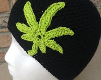 Black beanie with green leaf