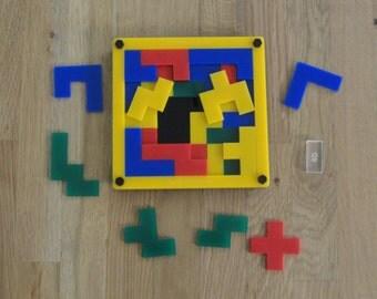 """Game puzzle jigsaw """"Squaroz"""" based on Pentomino (Polyomino) idea"""