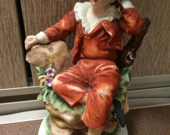 Lefton porcelain figurine boy in red sitting