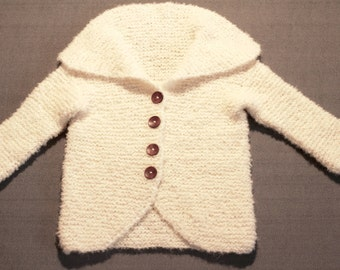 Hand-knitted, very light and fluffy coat for children