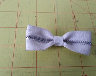 Adorable white zipper bow