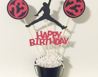 Jordan happy birthday centerpiece with 4 Jumpman cutouts.