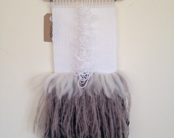 Wool wallhanging white, grey, charcoal with detail